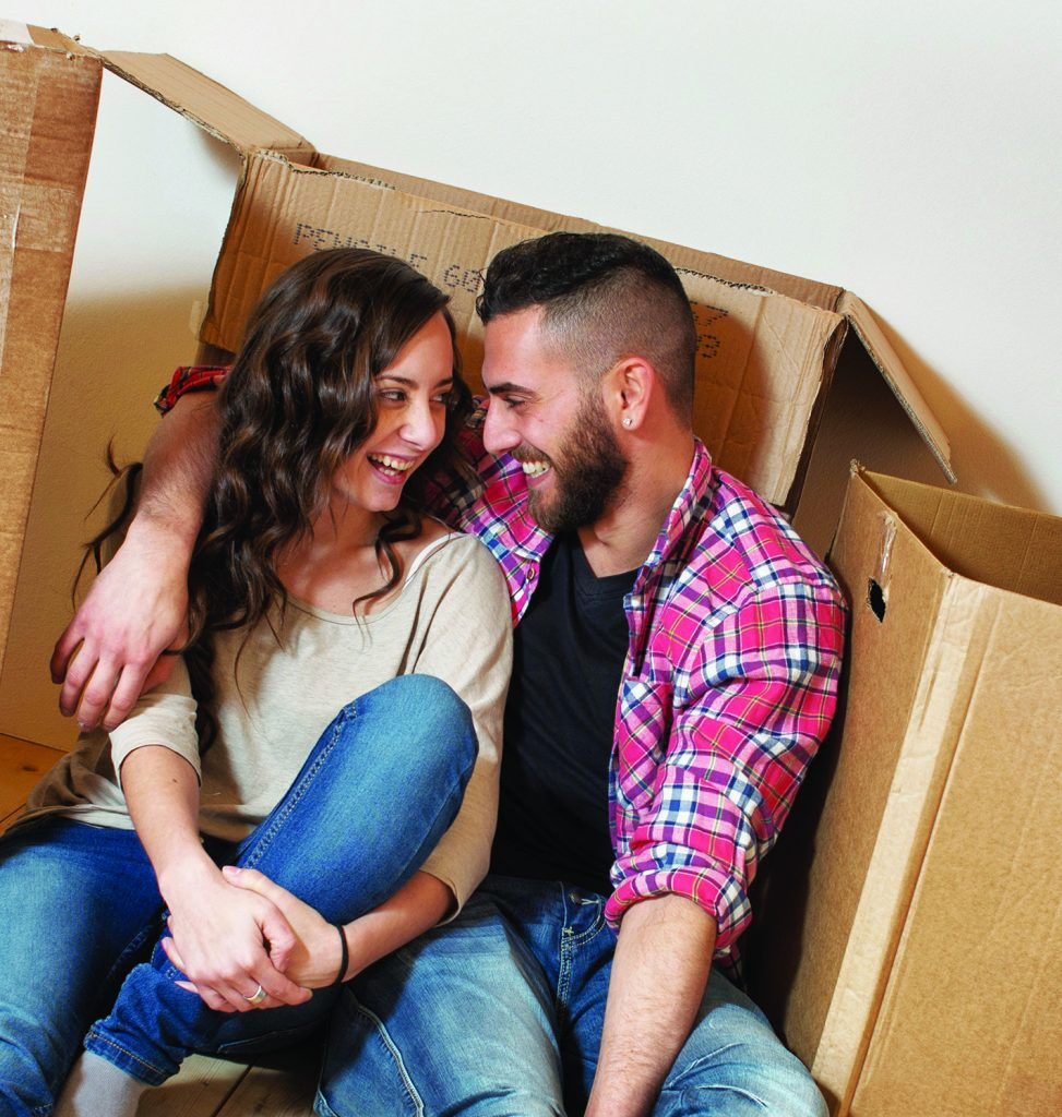 Couple relaxing in Attic During a Moving
